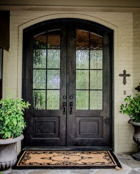 double doors at the front entrance with rain glass to keep some privacy