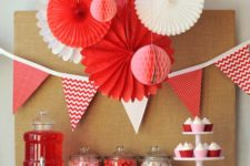 08 red and white paper fans and spheres are great for galentine's party decor