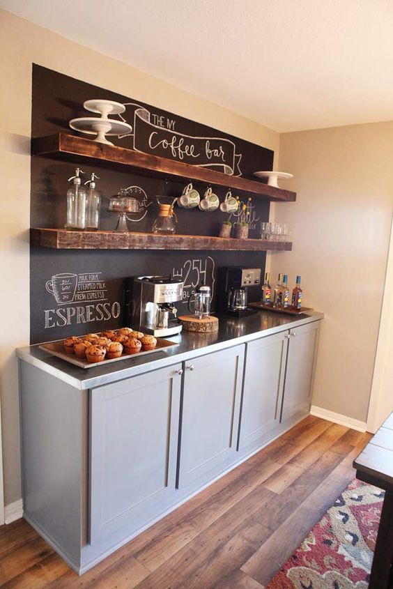 large drink station with a chalkboard, stained shelves and cabinets