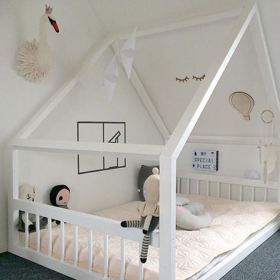 large frame house bed as a loft space with decor on the walls