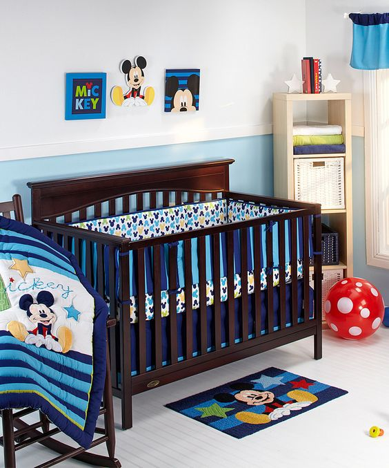 serene nursery in blue shades with Mickey touches