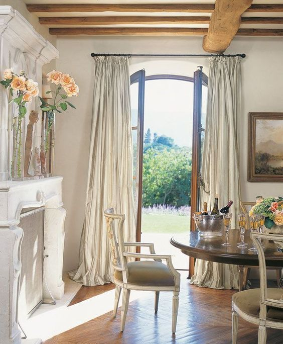 neutral striped curtains over the French doors