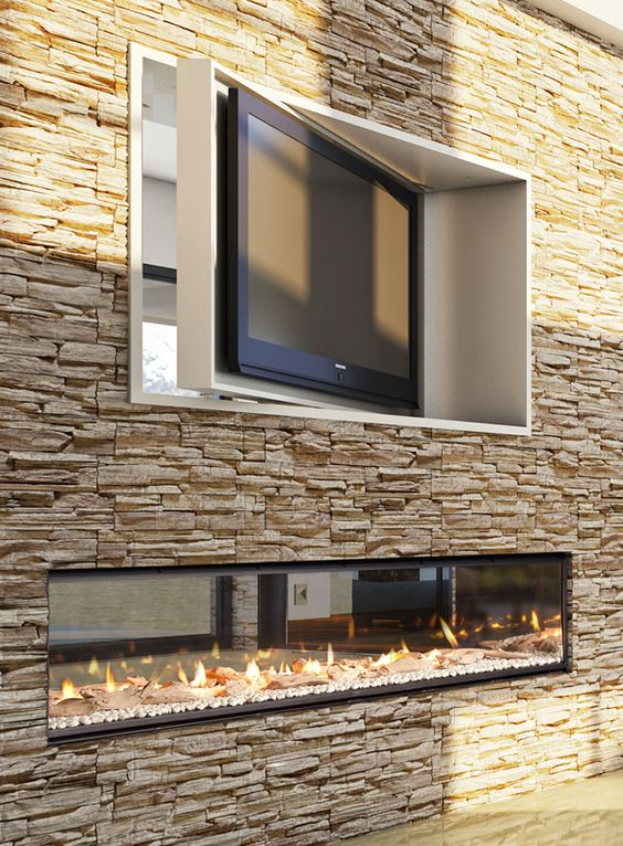 stone accent wall with a fireplace and a TV