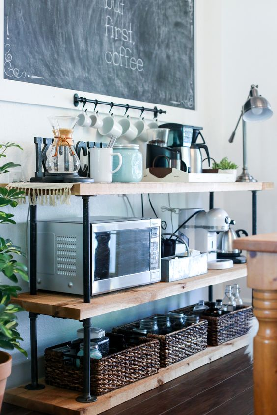 stylish coffee station with black piping and a chalkboard over it