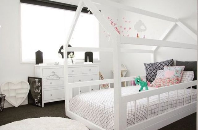 white frame house bed in a monochromatic black and white room