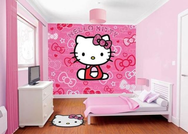 girl's room in shades of pink with a statement Hello Kitty wall