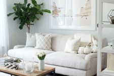 11 neutral colors and a medium-sized sofa make the space look bigger