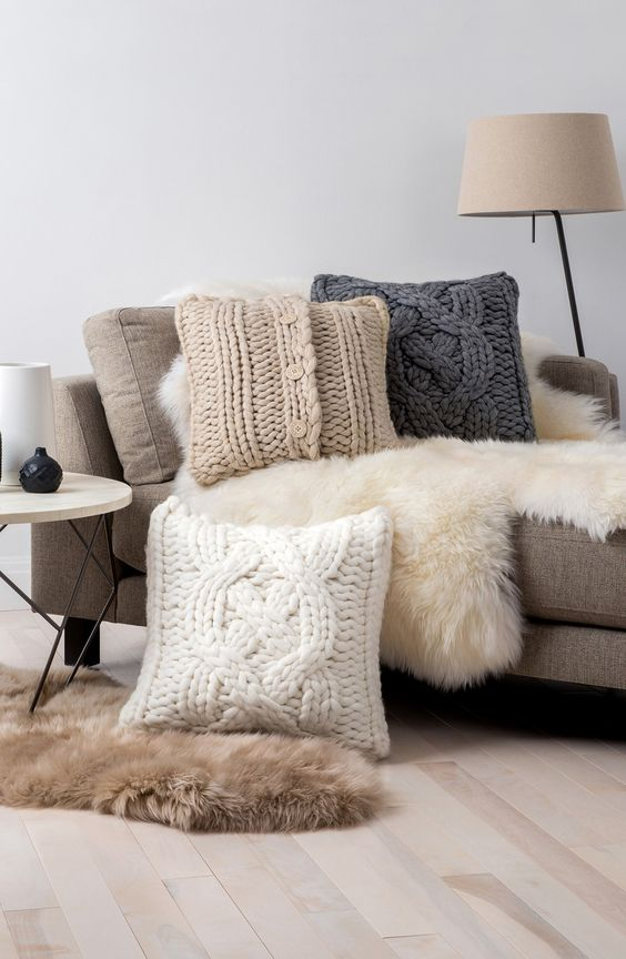 oversized cable knit pillows and faux fur for maximal comfort