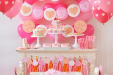 11 pink and blush decor with a lot of balloons and tassels