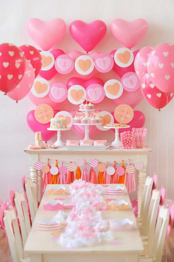 pink and blush decor with a lot of balloons and tassels