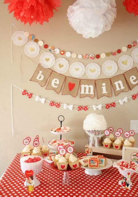 red and wwhite paper decorations for a galentine party