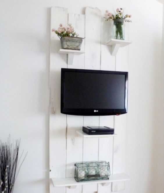 whitewashed pallet wood panel for the TV with shelves