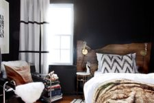 12 black walls and a white ceiling make room look bigger