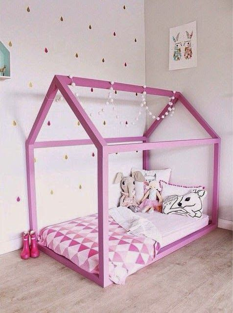 bold pink house frame bed with pompoms