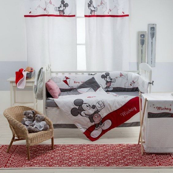 Unique neutral Mickey nursery decor with grye and red touches