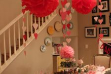 12 paper fans in red and pink, heart garlands and a striped table runner