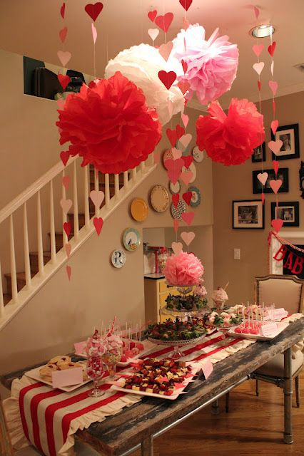 paper fans in red and pink, heart garlands and a striped table runner