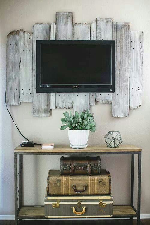 rustic weathered wood boards as a TV panel