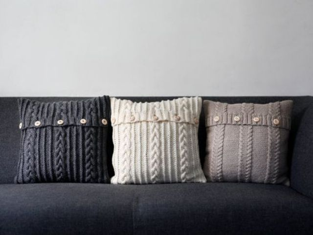 a trio of such pillows with buttons can be easily DIYed