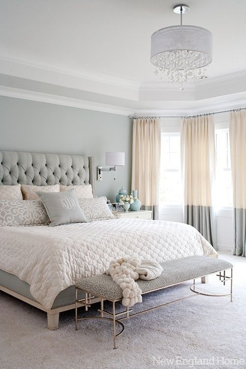pastel bedroom with color block curtains hung to the ceiling