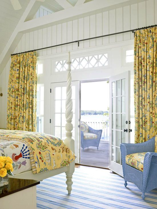 colorful printed curtains echo with the bedspread