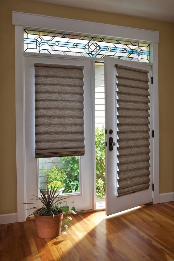 Roman shades of burlap will keep your space private