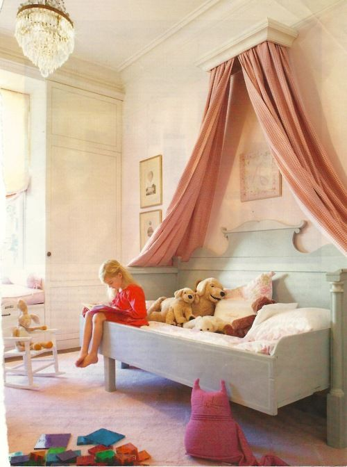 mint-colored bed with a pink canopy for a little princess