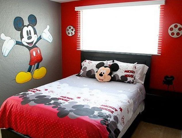 Fresh bold red bedroom with Mickey Mouse bedding and wall decor