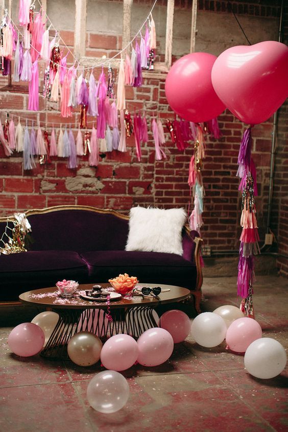 lounge decor with pink balloons and tassels