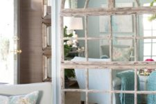 16 shabby wooden frame mirror that cover a whole wall