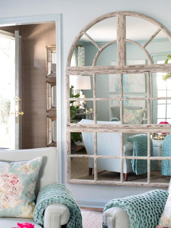 shabby wooden frame mirror that cover a whole wall