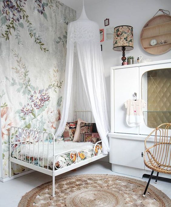vintage-inspired room, floral bedding and a white tulle canopy