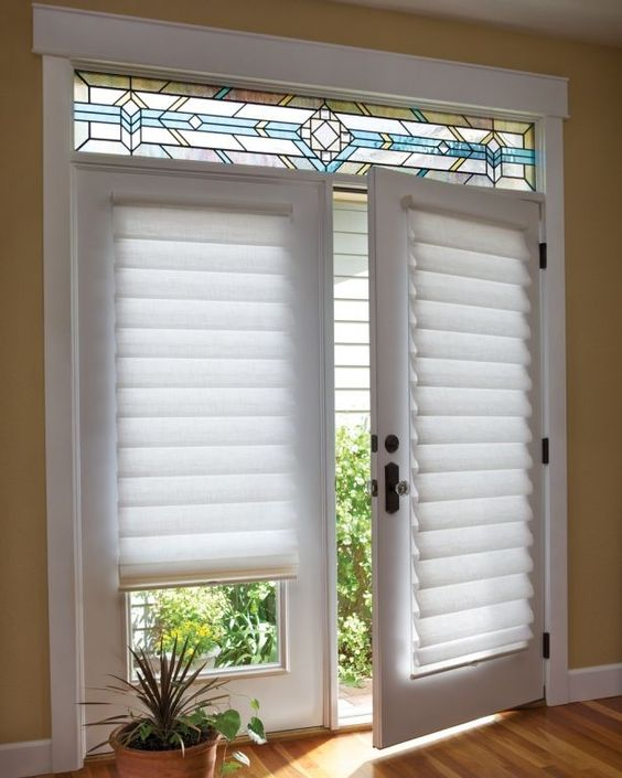 French doors covered with white tiered shades