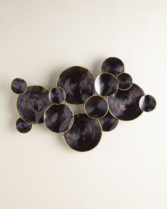 dark yet gilded 3D metal plates wall art
