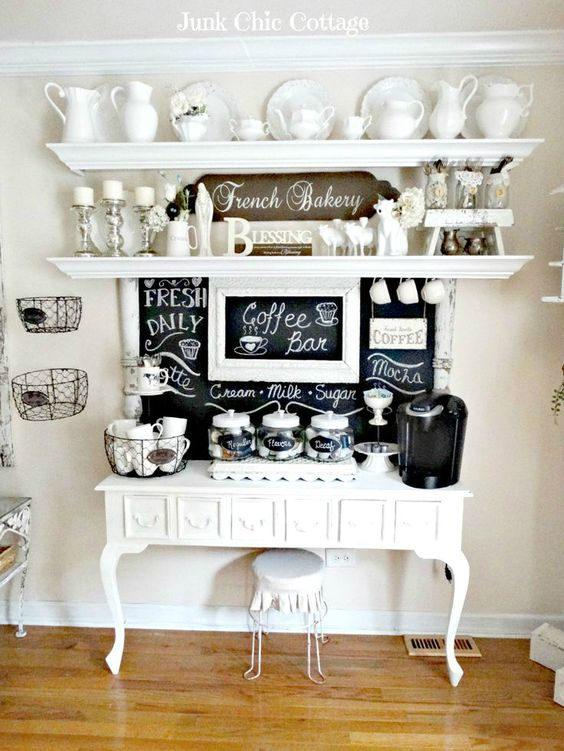 large drink station with a refined white console, a chalkboard and shelves over it