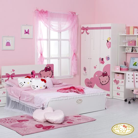 pink girl's room with Hello Kitty prints, pillows and decals