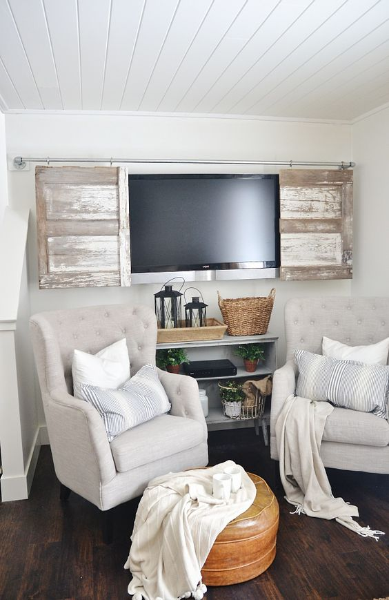 whitewashed wooden doors that cover a TV