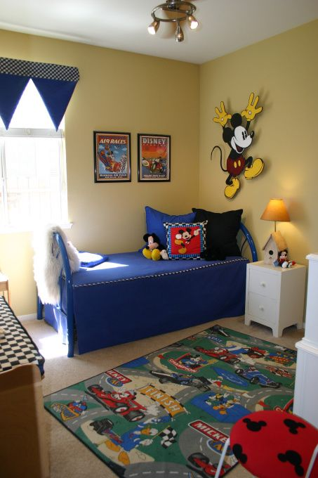 Inspirational boy us bedroom with blue and yellow shades and Mickey patterns here and there