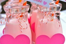 19 glass bottles with pink hearts and pink drinks for a gals' party