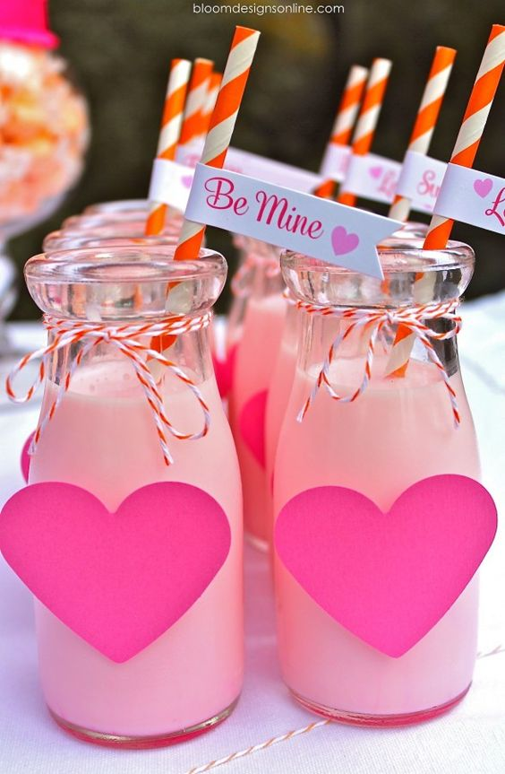 glass bottles with pink hearts and pink drinks for a gals' party