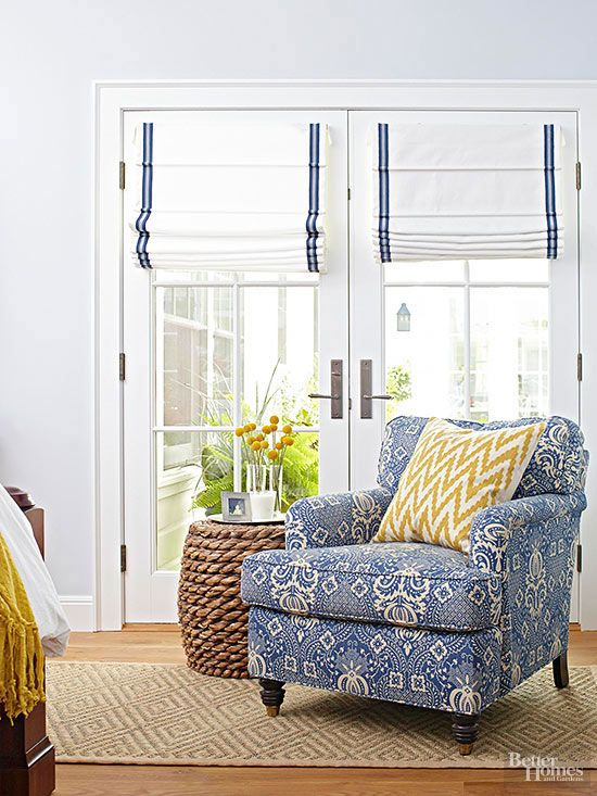 white and blue ribbon vertical shades perfectly match the room decor