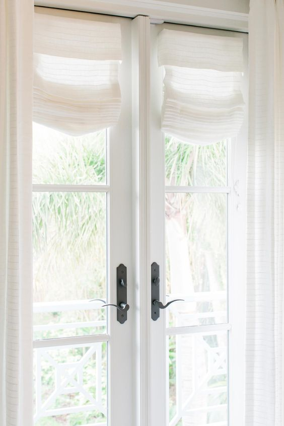 Simple, Wispy, White Window Treatments Hang On The French Doors
