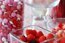 21 put red and pink foods and candy in various glass jars and vases as festive decorations you can eat