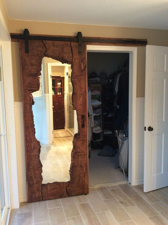 live edge wooden door with a mirror inserted