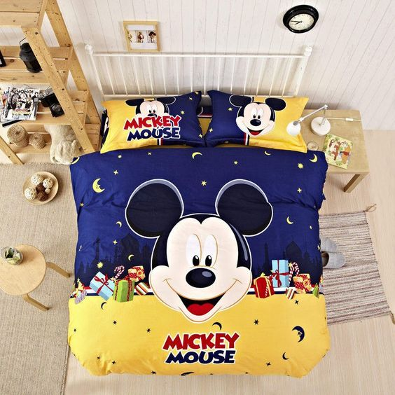 Unique neutral room decor and navy and yellow Mickey bedding