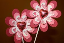 22 red paper flowers wwith candies can be favors or treats