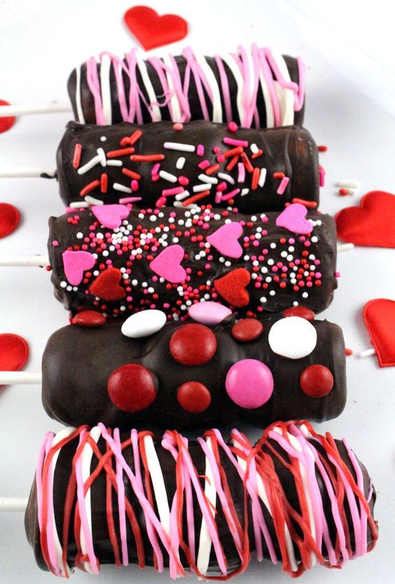 marshmallow wands glazed with chocolate and candies