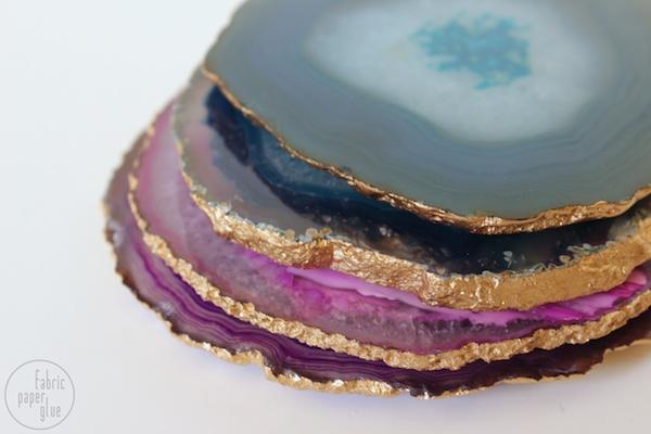 semi DIY agate slice coasters with cork bumps (via www.fabricpaperglue.com)