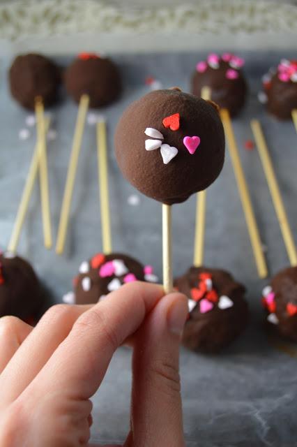 DIY cake pops with heart-shaped sprinkles (via www.atasteofmadness.com)