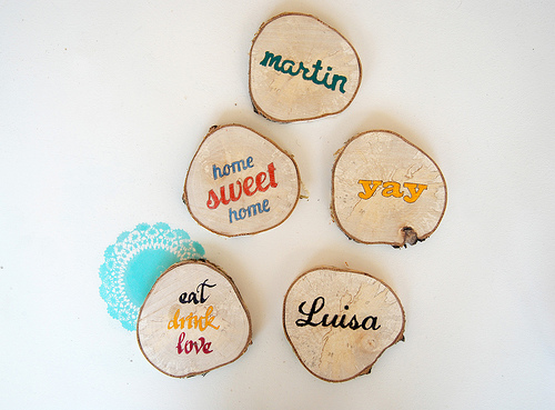DIY wood slice coasters with quotes and words (via www.shelterness.com)